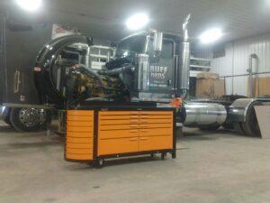Heavy duty steel workbench in front of big rig truck.