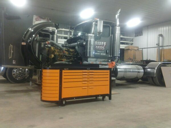 Heavy duty steel workbench in front of big rig truck.